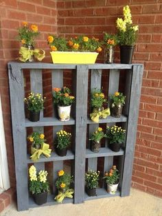 Create a space for potted plants with a painted pallet.
