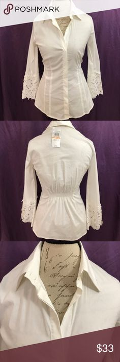 """NWT BCBGMaxAzria button front white cotton shirt Cotton button front blouse with crochet detail on sleeves. Deep neckline and cinched waist. Armpit to armpit: 18"""". Sleeve length: 21"""". Shoulder to hem: 26"""". BCBGMaxAzria Tops Button Down Shirts"""