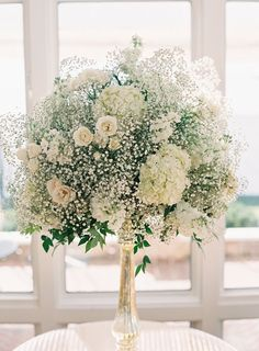 Baby's breath and spray rose centerpiece.