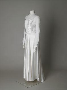 Wedding dress of rayon satin and machine made lace, 1945, English…