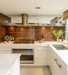 This White Corian Macassar Ebony #Kitchen is really lovely. All the white and brown tones create such an earthy vibe. www.remodelworks.com