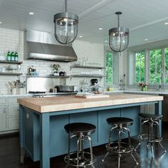 An Artisan Kitchen- love the fun island color