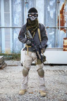 Airsoft Player in Japan. Fashion Photo. Gore-tex jacket. Military. Gun. Combat