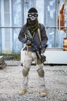 Airsoft Player in Japan. Fashion Photo. Gore-tex jacket. Military. Gun. Combat
