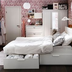 So this is what Mike was talking about Huh (the under the bed storage) Very cool. Love the shoe wallpaper :)