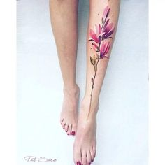 Magnolia tattoo on the left shin.