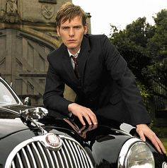 All change: The young Endeavour Morse leans on a black police Jaguar - prequel to Morse series is set in 1965 and stars Shaun Evans as the young Endeavour Morse just starting out on his police career.