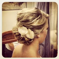 Such a pretty updo with flowers.