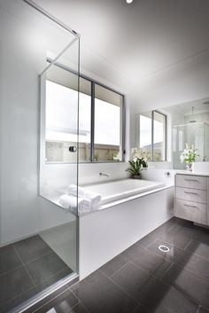 Gray And White Bathroom With Separate Shower And Bathtub