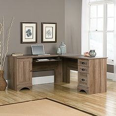 Tired of stuffy-looking L-shaped desks? This one has some character, with its stylish moldings, classy hardware, and salt oak finish. It also offers a generous file drawer, built-in wire management, a