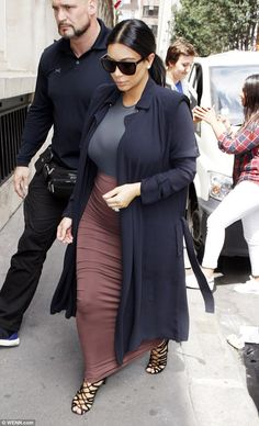 Low-key arrival: The reality star was seen leaving couture fashion designer Alexandre Vautheir's office in a stylish ensemble, which kept her growing bump under wraps
