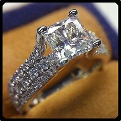 love the split shank, i think the middle band is the wedding band. if it's not it would be cool if it were! one or the other shouldn't have diamonds though