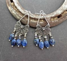 Blue gemstone and silver chandelier earrings. Sodalight stone and sterling silver.