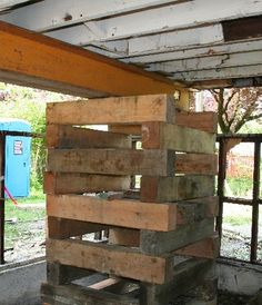 Wooden cribs and a steel beam are used to temporarily suspend a house above its foundation Basement Repair, House Lift, Wooden Cribs, Raised House, House Foundation, Steel Beams, Moving House, Beach Cottages, Beach House