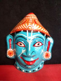 A beautiful handcrafted papier mache mask of by PattachitraNet