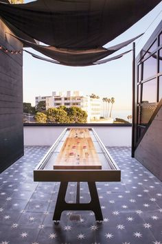 Outdoor patio space with a shuffleboard table