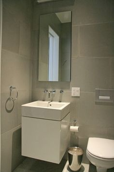 Concrete wall panels and batchroom floor - modern - bathroom tile - new york - by Concrete Shop