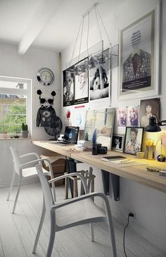 Office/study/workspace for two: long, wall-mounted wooden desk, white fibreglass chairs, white floorboards
