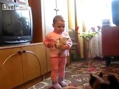Clueless humans set this situation up and thank God Mama Cat Teaches Toddler How To Treat Her Kitten
