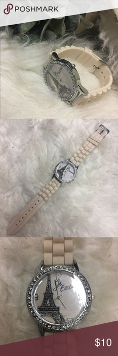 """🛍3 for $15🛍 Rubber Paris Watch Eiffel Tower with """"Je T'aime"""" watch, a diamond detail around the face with a blush pink rubber wrist band. Never used, from rue 21. A total of about 9.5 inches long. Offers are welcomed and I love to bundle so check out the rest of my closet and no trades or holds please.   $8 by itself, or get 3 for $15 when you bundle 3 items included in the sale. Rue 21 Accessories Watches"""