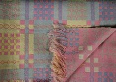 Yes indeedy!  Lovely design and colour mix.  [A Welsh wool blanket   typical motifs I think]