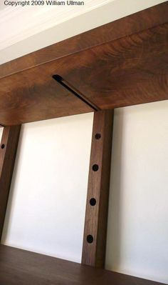 """WMSLG: LARGE THRU-BLOCK WALL MOUNTED ADJUSTABLE SHELVING The """"Thru-block"""" wall mounted shelving system is also available in reclaimed Oregon black walnut (OBW) in two sizes (See specs below). The vertical supports are 1 1/2"""" W x2"""" D x 58"""" L, with ¾"""" diameter holes, spaced at 3-½"""" OC in order to allow for maximum adjustment to shelves. The shelving """"planks"""" are 1-1/2""""-thick x 10""""-deep x 4'-0""""-wide. Individual ¾""""-diameter x 9""""-long OBW dowels are included for shelf support and book stops. A…"""