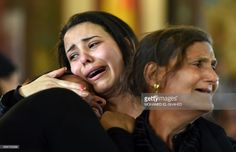 TOPSHOT - Women mourn for the victims of the blast at the Coptic Christian Saint Mark's church in Alexandria the previous day during a funeral procession at the Monastery of Marmina in the city of Borg El-Arab, east of Alexandria, on April 10, 2017.Egypt prepared to impose a state of emergency after jihadist bombings killed dozens at two churches in the deadliest attacks in recent memory on the country's Coptic Christian minority. / AFP PHOTO / MOHAMED EL-SHAHED        (Photo credit should…