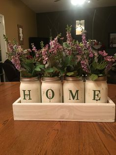 Chalk Paint Mason Jars with Cricut Lettering Source by susanmccraine Painting Canning Jars, Chalk Paint Mason Jars, Painted Mason Jars, Mason Jar Projects, Mason Jar Crafts, Mason Jar Diy, Table Centerpieces For Home, Jar Centerpieces, Quinceanera Centerpieces