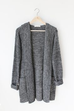 """- Details - Size - Shipping - • 100% Acrylic • Thick knit marled cardigan with hood and front pockets • Hand Wash • Line dry • Imported • Measured from small • Length 30.5"""" • Chest 21"""" • Waist 20"""" - F"""