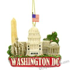 "Washington DC Christmas Ornament with Landmarks A great ornament of Washington DC for your Christmas tree or shelf. Our poly D.C. Christmas ornaments feature The Capitol Building, Washinton Monument, Lincoln Memorial, Jefferson Memorial and Cherry Blossoms with WASHINGTON DC written on the front of the ornament. From the Kurt Adler, , collection,we are pleased to offer this DC Christmas ornament, and we are sure they will be cherished in your family for generations. Measures 2.75""W x 3""H x…"