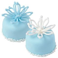 Welcome winter with the cool blue color of these blossom-topped treats. The delicate looped petals are made in advance with royal icing.