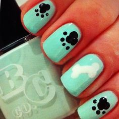 Aqua dog nail art. Use a dotting tool and make three dots close to each other to make the paw. Then, using the small dotting tool make four dots as the nails of the paw.