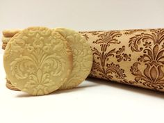 Embossing rolling pin with Damask pattern  This design is a fun way to enhance home-made cookies or even texturize hand-made pottery. This item makes a