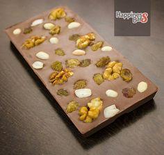 Milk chocolate happiness bar with toasted peanuts, walnuts and raisins.