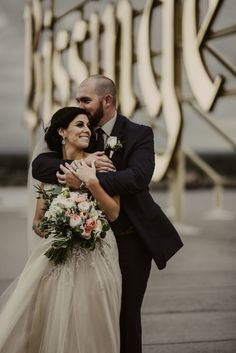 Elegant Rooftop St. Louis wedding at Bissinger's Caramel Room - Urban wedding - soft muted palette - St. Louis wedding photographers - The Rowlands Photography and Filmmaking
