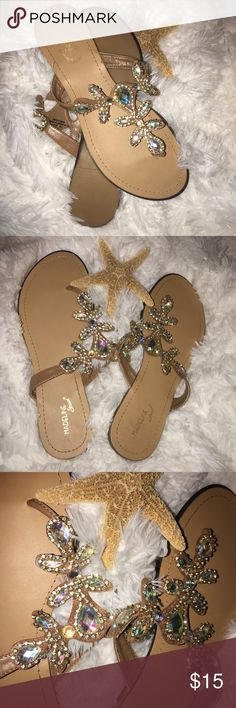 Madeline Size 10 Jewel and Gem Slip On Sandals Madeline Size 10 Jewel and Gem Slip On Sandals. Tags have been taken off but never Worn. Super pretty sparkly Gems strappy Sandals. NWOT Madeline Shoes Sandals