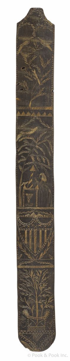 """Carved New England baleen busk, ca. 1800, with an American shield, a memorial scene, and trees, 13 3/4"""" l."""