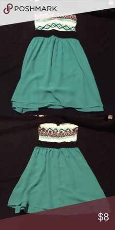 Sun dress Turquoise sundress. The top is an Aztec pattern with built in cups. Very soft material. The waistband is an elastic material. The bottom is very flowy Rue 21 Dresses Strapless