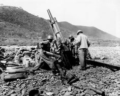 American 105mm Howitzer M2A1 crew of Battery A US 159th Field Artillery Battalion firing their weapon near Uirson Korea 24 August 1950.