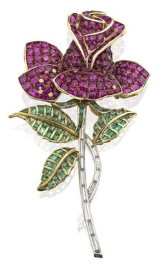 A gem-set brooch, 1940s. Realistically modelled as a rosebud, the petals set with calibré-cut rubies and circular cabochon-cut ruby accents, the leaves with emeralds and the stem with baguette-cut diamonds.