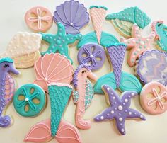 Under The Sea Birthday Party Cookies-Sand Dollar, Mermaid Tails, Conch Shells, Starfish. TheIcedSugarCookie.com Kessa Cakes
