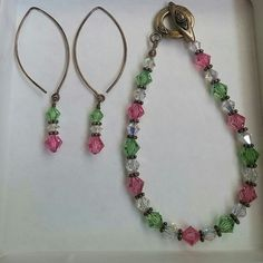 """Glass Bead Bracelet & Earring Set Beautifully beaded with clear, green, pink and metal beads. Never been worn but the metal on both the earrings and bracelet is tarnishing. May be able to clean off some. Earrings measure 2.25"""" long and bracelet is about 7"""" long  * no trades/holds  * anyone asking for """"lowest"""" will be ignored * reasonable offers considered but ONLY using the offer function! Jewelry"""