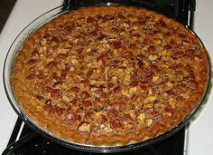 Traditional PECAN PIE -Made with MAPLE Syrup :    9 in. pie crustprebaked   6 oz. pecans, toasted  4 Tbs. butter,   3 large eggs  1/2 cup granulated sugar  1 cup maple syrup  1/2 tsp. salt