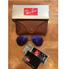 Ray ban aviators blue violet flash lense Authentic Ray ban aviators blue violet flash lense. Purchased from the official ray ban site online. Brand new, in perfect condition and have never been worn. The box was only opened to take these pictures. The frame is a bronze-copper color. Style number on the Ray ban website is: RB3025 167/68 58-14. This purchase includes: the sunglasses, case, box, sunglass cleaner cloth & info booklet. Feel free to make an offer. Ray-Ban Accessories Sunglasses