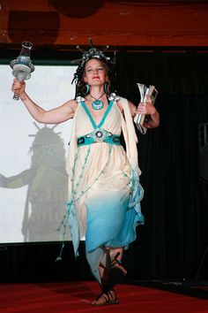 """""""Our Lady of Obsolescence"""" by Korrine Krielkamp, model Brandi Mayes. Made of packaging supplies, old glassware. Featured in the 2012 Junk2Funk Eco-Fashion show, a benefit of the Kootenai Environmental Alliance that showcases the runway outfits made from recycled materials by local artists."""