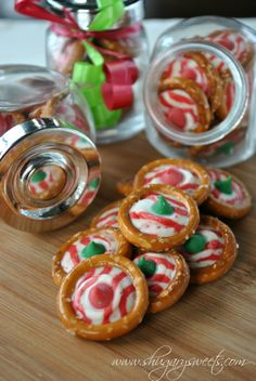 Pretzel Rings with Candy Cane Hershey Kisses- one of the easiest holiday treats made for Cookie Exchange 2013. Used green mint M  Ms instead of colored chips.