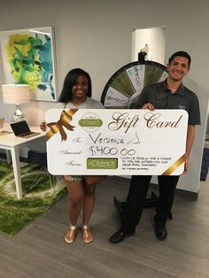 """Veronica and Mario knew it was time for her to sign! When """"wheel"""" you?! Come sign a lease today and don't pass up the amazing giveaways coming YOUR way! Contact the District on Kernan to learn more! #megagiveaway #spintoday #youspinmerightround #jax #dok"""