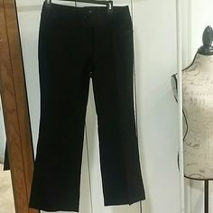 Banana Republic Martin fit pants Black and in excellent  condition. They are very nice dress pants. Dry clean only. 56% rayon 39% cotton and 5% spandex. They are a size 8s. Banana Republic Pants