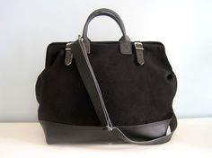 A-HA! the perfect sturdy yet sleek lug-all - a black canvas tool bag.