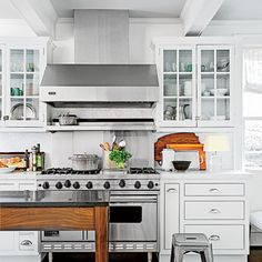 Put the lightest color on the walls, go one shade darker on cabinets, and then go one shade darker than the cabinets on the ceiling. My colors—Benjamin Moore's Horizon, Alaskan Husky, and Sleigh Bells—are all from the same paint card.